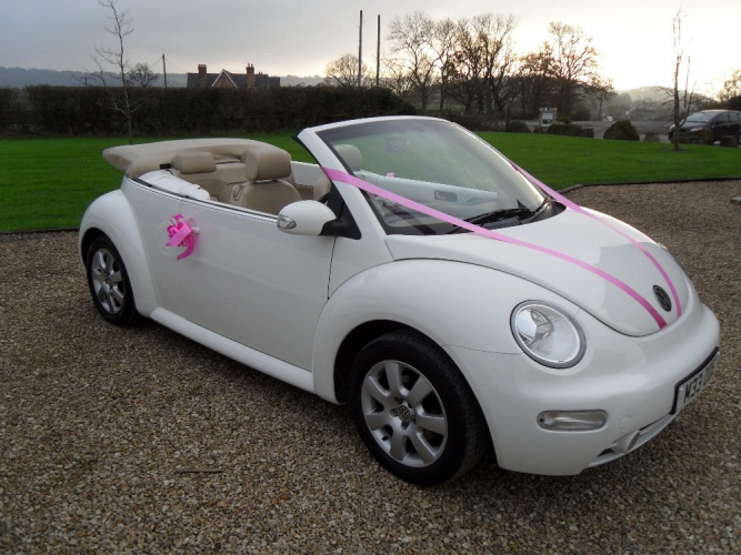 White Beetle Convertible with ivory leather interior by RR Elite Cars.